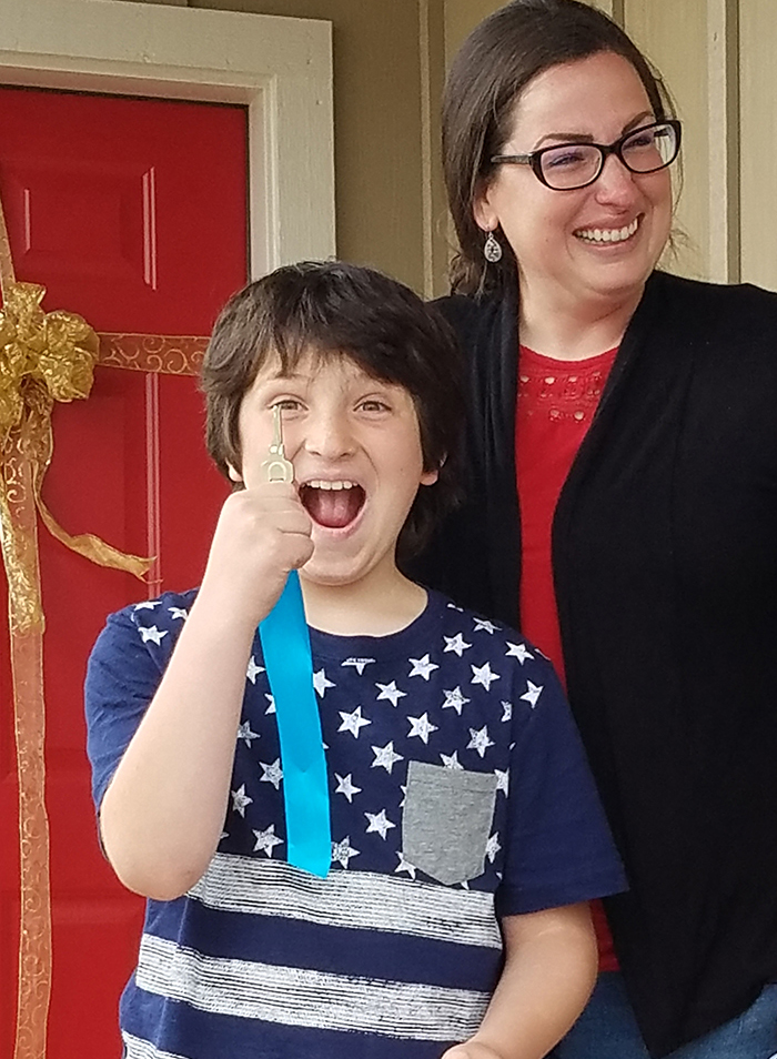 Kirsch Key Dedication excited new home homeowner